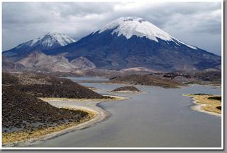 Volcanos Parinacota and Pomerape above Lagunas Cotacotani, Altiplano, Chile