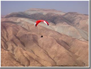 Carlos Curi paragliding at Caleta Colorada, Iquique, The Atacama Desert, Chile