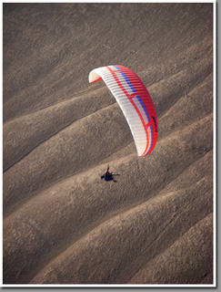 Warren Stadler from USA paragliding at the Tiliviche Canyon, Pisagua, Atacama Desert, Chile
