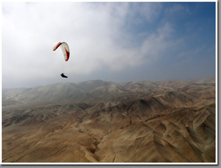 Paragliding over the platou above Punta Piedras North of Iquique, The Atacama Desert, Chile