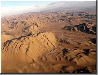 Sunset paragliding over The Barefoot Dunes, Cerro Oyarvide range, Iquique, The Atacama Desert, Chile