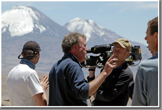 BBC Filming crew and presenter Jeremy Clarkson on the slopes of Guallatiri Volcano shooting BBC Top Gear Bolivia Special, Altiplano, Chile