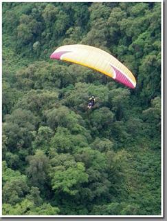 Carlos Curi flying his Niviuk Artik 2 paraglider over Loma Bola, Aconquija Range, Tucuman, Argentina