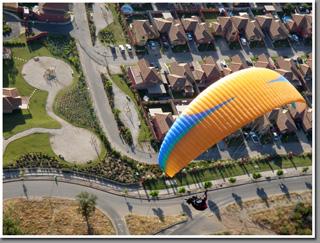 Niviuk paraglider flying over Las Vizcachas, Santiago de Chile, Chile