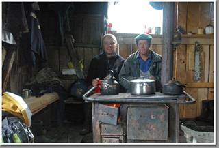 Aladdino Varga and Jarek Wieczorek (the host of this blog) getting warm and dry in a cold Patagonian morning in a settlers' house, Steffen Fjord, Aysen, Patagonia, Chile