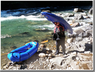 A packraft and a kayaker at the put out at Rio Manso de Frontera at the border between Argentina and Chile, Patagonia, Argentina.