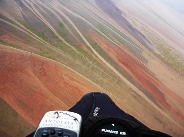 The other face of the desert - Paragliding along the coastal mountains near Pabellon de Pica during 2015 flowering desert event, The Atacama Desert, Iquique, Chile