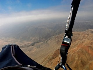 Up in clouds - Jarek Wieczorek gliding along the Atacama Desert coastal range in the Loa river area, The Atacama Desert, Chile