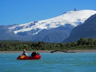 Packrafting Rio Palena - Rivers of Patagonia - Packrafting rio Palena with volcano Melimoyu in the background, Patagonia, Chile