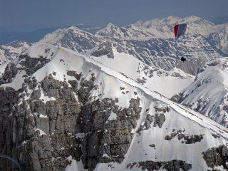 Over Krn - Spring paragliding over Krn - the highest mountain around Soca Valley, Julian Alps, Slovenia