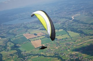 The other side of glass - Your host Jaroslaw Wieczorek flying his Aircross USport2 paraglider over large inter-mountain valley of Zywiec basin in Beskid Mountains, Poland. Photo by Kinga Konieczny.
