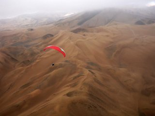 Into The Desert - Paragliding over mountain dunes near Cementerio 2 south of Iquique, the Atacama Desert, Chile
