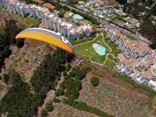 Marbella - Paragliding above Marbella resort town near Mantencillo, the Pacific coast of central Chile