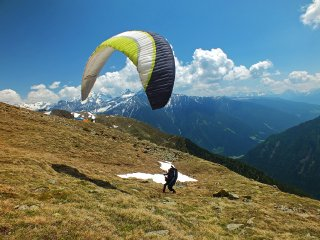 Epic weekend in Eastern Alps - Your host - Jarek Wieczorek - taking off with his paraglider from Speikboden, South Tyrol / Alto Adige, The Alps, Italy