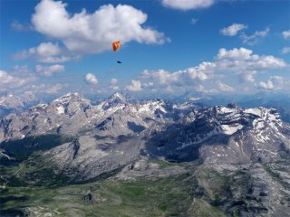 Dolomites under my feet - Paragliding above the Dolomites during a long cross country flight in South Tyrol, Italy